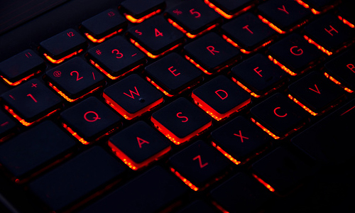 Keyboard with keys backlit by red light